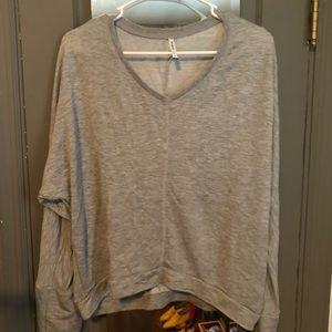 Gray long sleeved oversized v neck tee